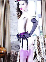 Gloved babe in a chic frilly gown with pink nylons and a matching suspender
