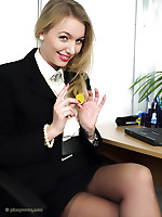 Blonde secretary in seamed stockings shows her secrets in the office