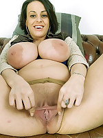 Vicky - Massive tits, big areola nipples and an outstanding puffy pussy. See Vicky stretch her bald pussy wide open again