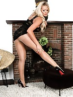 Long legged Lucy Zara wearing glossy pantyhose and sexy lace dress