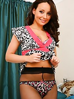 Gorgeous brunette Carla looks great as she seductively removes her sexy mini dress