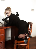 Michelle in prim suit, vintage nylons and sheer panties