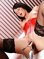 Check out a hot babe in red lingerie as she uses a horse speculum to satisfy herself. She gets wild when she puts it inside and opens up her pussy