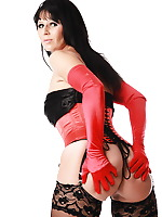 Desyra has a sexy red corset and a combination with black stockings. She has a fantastic body and she has a fetish for stockings and fishnets, she is ready to share both with you